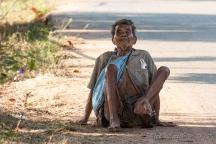 Blind village beggar.